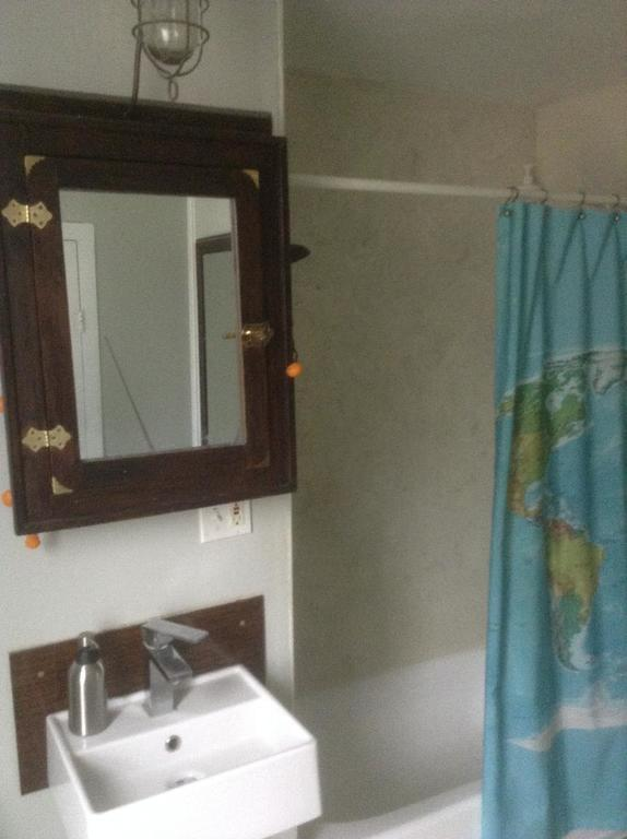 The main bath. (There's a 1/2 bath upstairs.)  It was renovated 2 years ago.  The shower walls are marble.