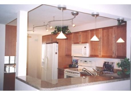 Granite bar between kitchen and dining area