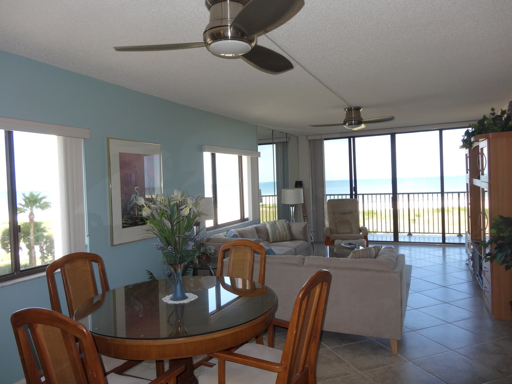 Dining area and living room look out onto the beach