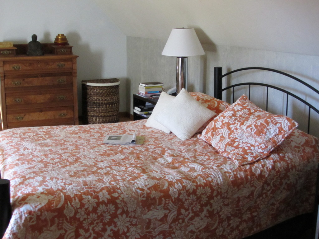Queen-sized bed in master bedroom. There's lots of space for you to put your clothes.