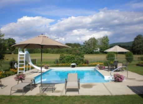 36 foot pool in back yard. Note: Slide and diving board recently removed because of insurance liability costs.