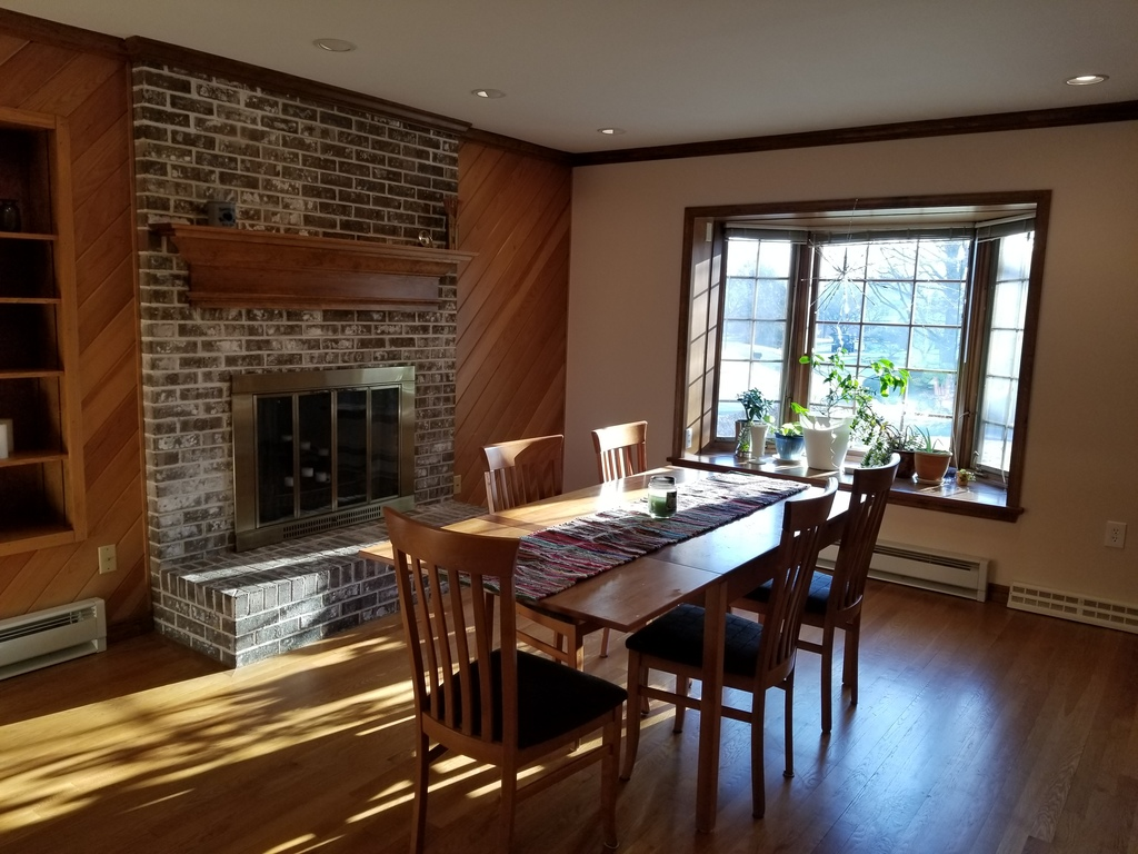 Dining room with fireplace. Table expands for additional seating.