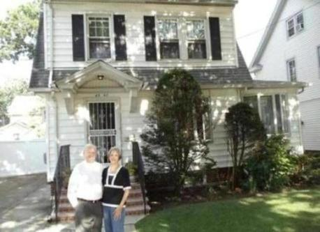 Tony and Margaret in front of home