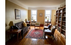 Our sun-filled, spacious living room with lots of books