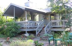 Rear of home with outdoor deck