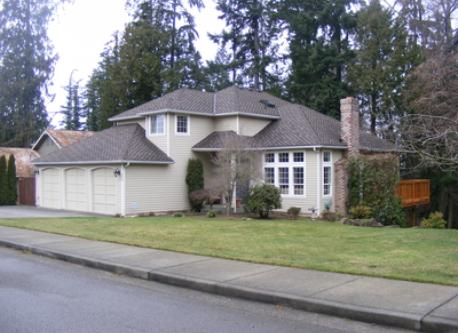 Large front yard with fruit trees, garage parking.  Private backyard.
