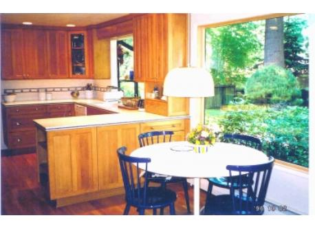 The kitchen overlooks a green and private back yard. The neighbors are friendly.