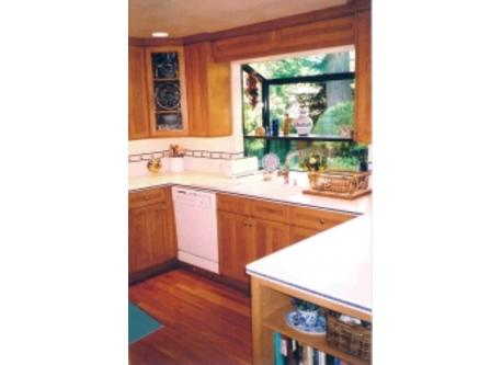 Garden window facing rear yard, Corian counter-tops, modern appliances.
