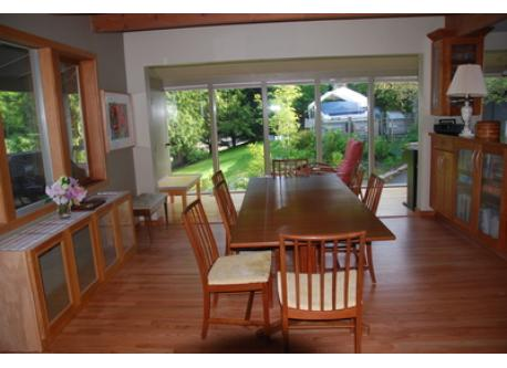 dining room opens to deck and sunspace windows
