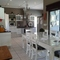 Oudtshoorn: Living-room to kitchen
