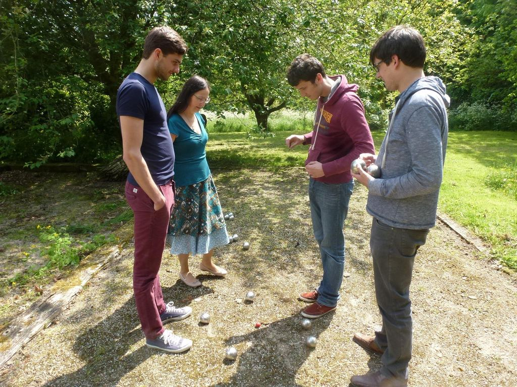 Playing Petanque with Lut our son & son-in-law in our garden