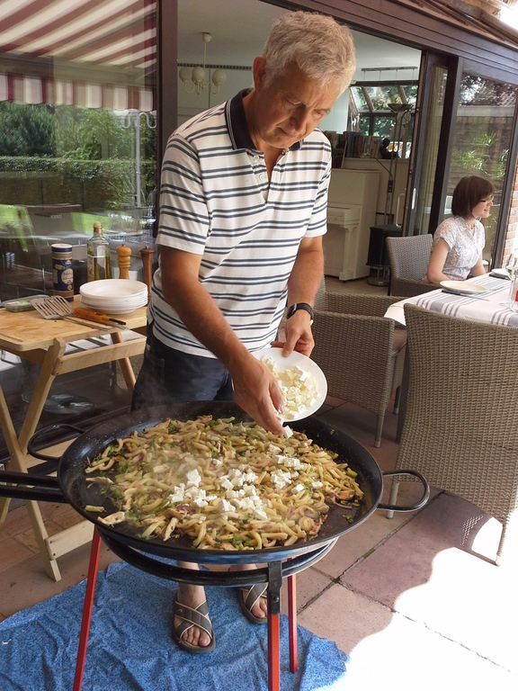 Bruno cooks on the paëlla pan