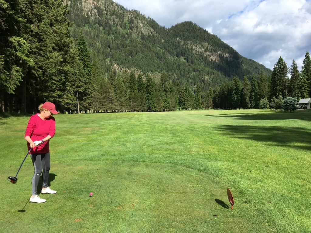 Theresa golfing at a mountain course
