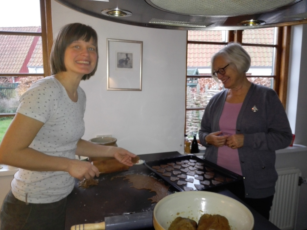 My mom and sister baking christmas cookies.
