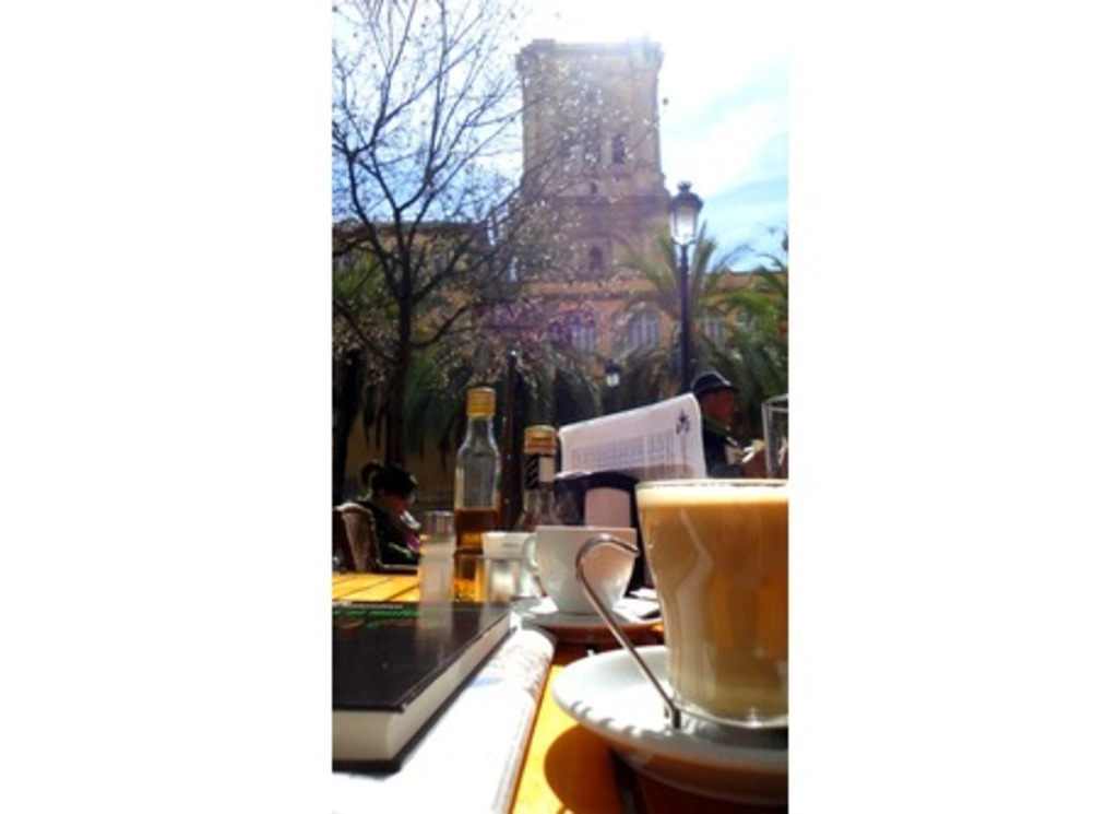 Our neighborhood: Breakfast on Sunday morning, in our favourite cafeteria, with the cathedral's tower in the distance