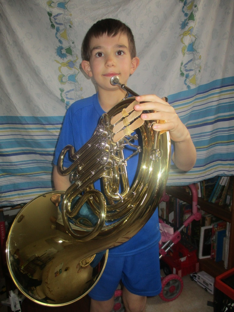 Antoine 10 years old likes athletics and playing the Horn