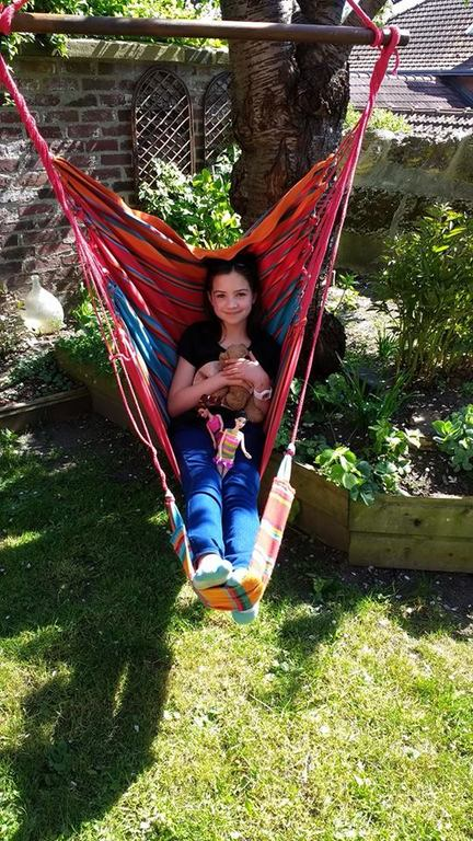 Tiz in a hammock chair in a swap in Rouen, France