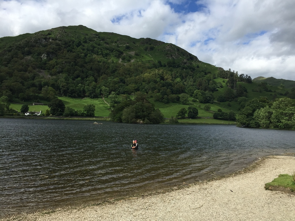 Family swimming in Rydal Water a 25 minute drive in the Lake District