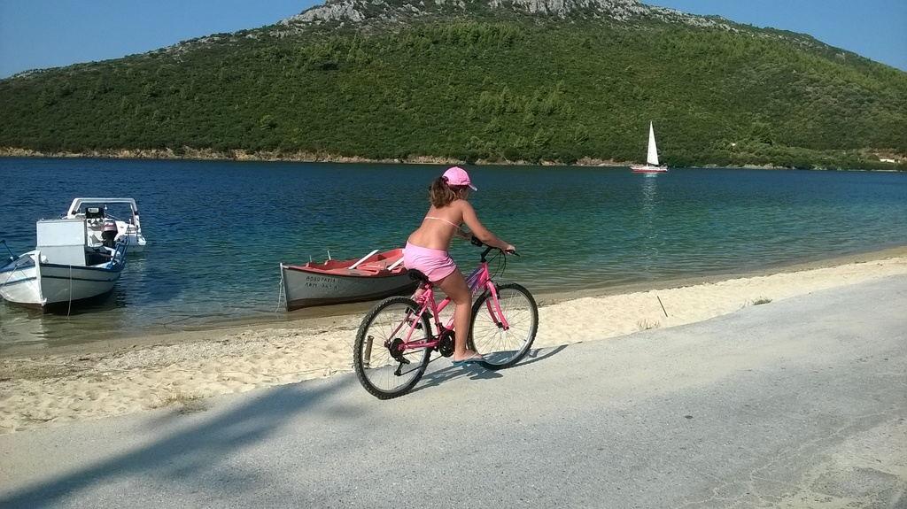 Maria biking at Porto Koufo