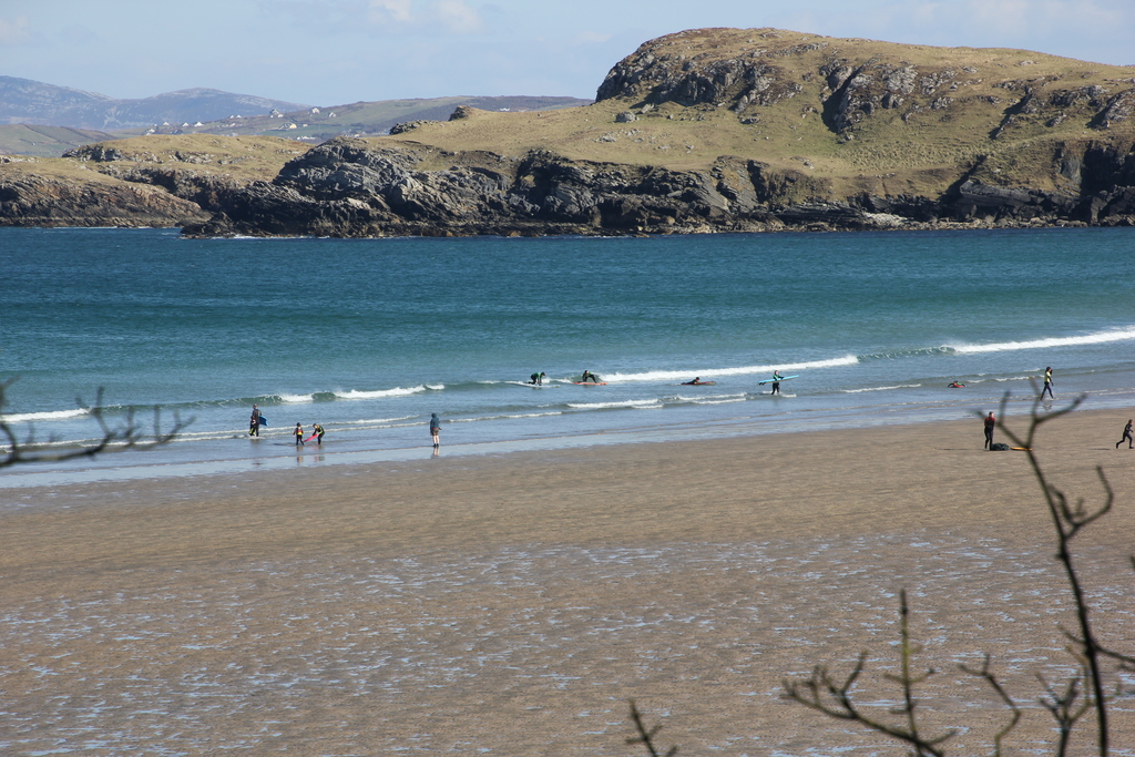 surfing on Marble Hill Beach below the cottage