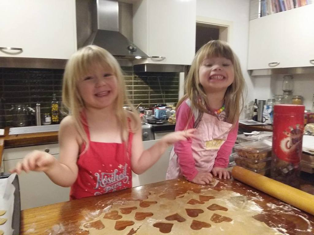The girls helping with christmas baking