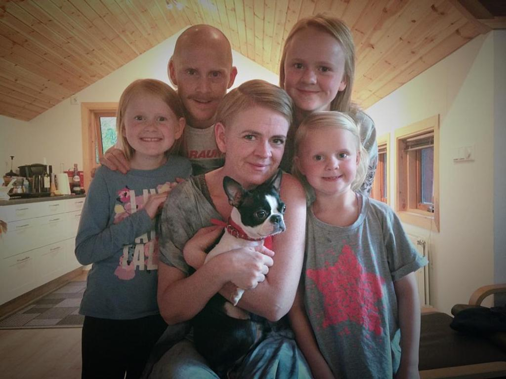 The family and our Boston terrier Regina