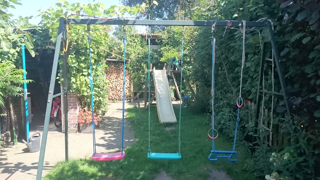 There is a slide and swing in the garden