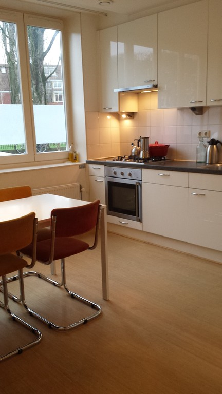 Part of kitchen and dining table