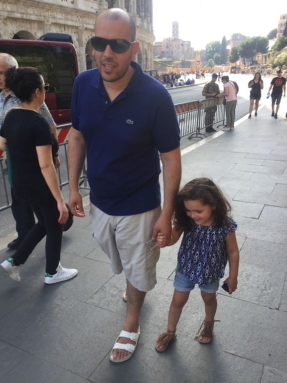 Dad with oldest daughter in the streets of Rome