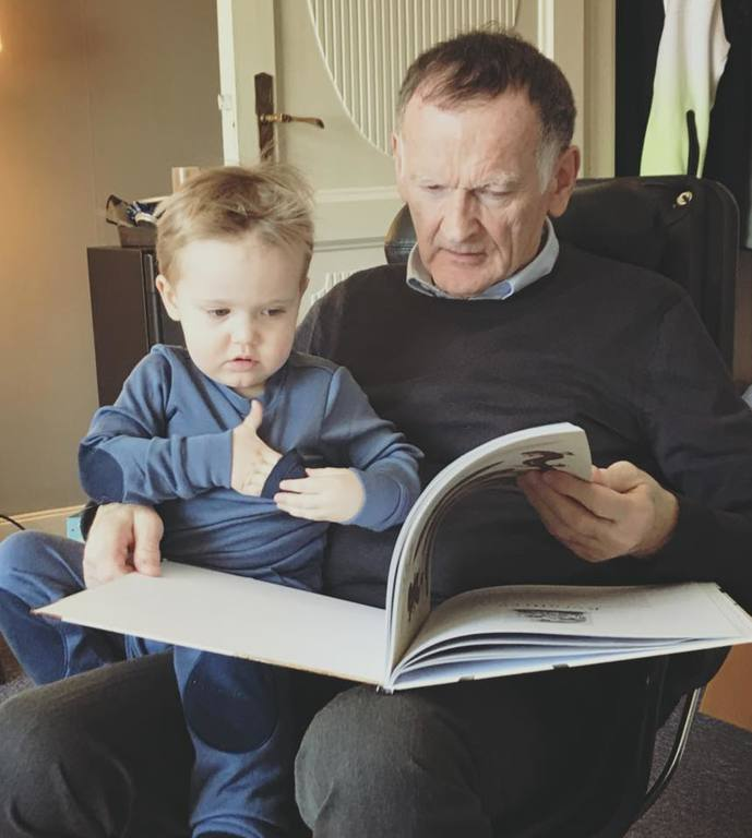 Reading for grandson Axel