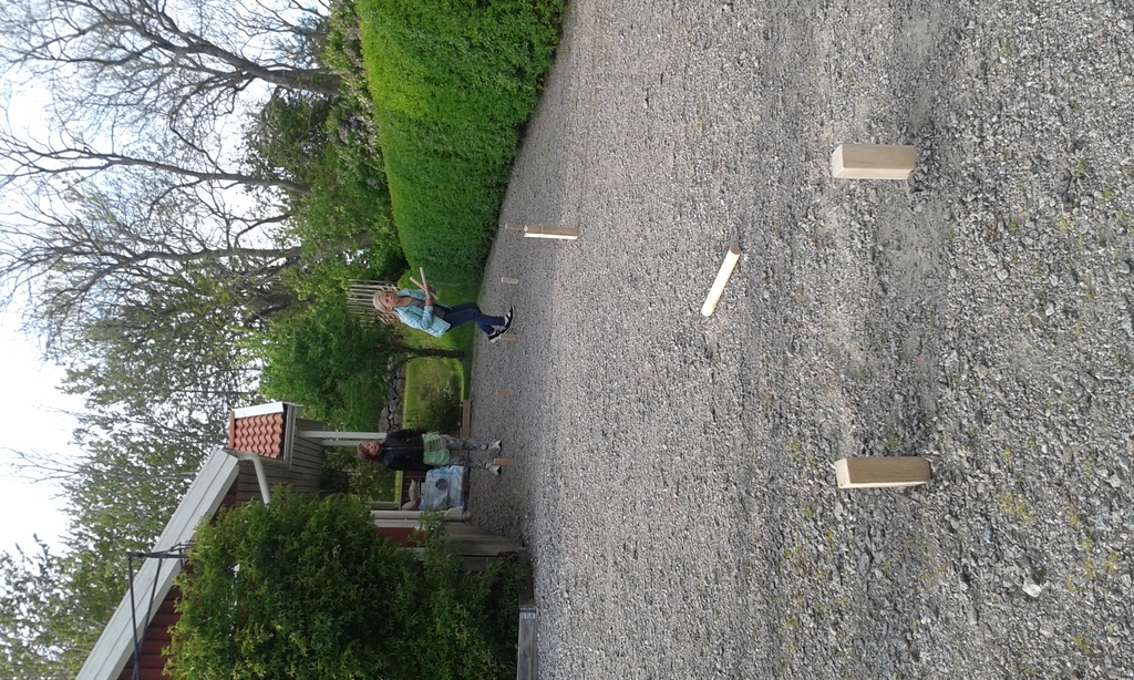 "Family tournament in popular swedish ""Kubb"" game."