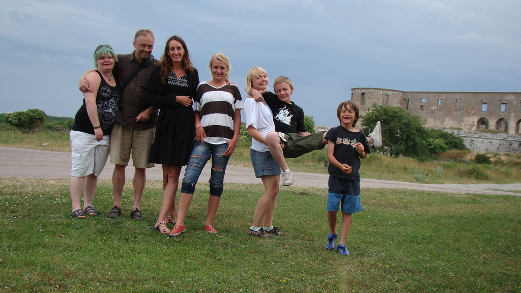 This is us! The picture is a few years old, taken at Öland, by the famous ruin of Borgholm.